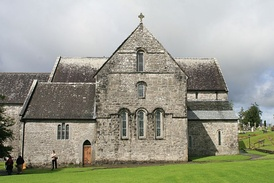 Ballintubber Abbey, An Augustinian priory founded in the 13th century, suppressed in 1603 and burned in 1653; but continually re-occupied and used for Catholic services, and re-roofed in the 20th century