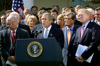 President George Bush, surrounded by leaders of the House and Senate, announces the Joint Resolution to Authorize the Use of United States Armed Forces Against Iraq, October 2, 2002.