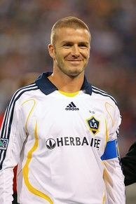 Beckham (with a blue captain's armband) became LA Galaxy captain immediately upon joining the team