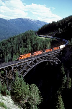Long freight train crossing the Stoney Creek viaduct on the Canadian Pacific Railway in southern British Columbia