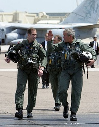 President Bush, with Naval Flight Officer Lieutenant Ryan Philips, after landing on the USS Abraham Lincoln prior to his Mission Accomplished speech, May 1, 2003