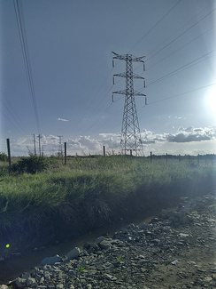 High Voltage Pylons carrying additional optical fibre cable in Kenya