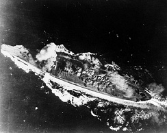 Yamato hit by a bomb near her forward gun turret in the Sibuyan Sea, 24 October 1944