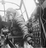 Lancaster pilot at the controls, left, flight engineer at right