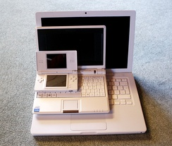 Difference between screen sizes in some common devices, such as a Nintendo DS and two laptops shown here.