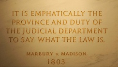 Inscription on the wall of the Supreme Court Building from Marbury v. Madison, in which Chief Justice John Marshall outlined the concept of judicial review