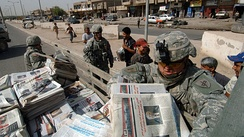 U.S. Army PSYOP soldiers with Detachment 1080, 318th Psychological Operations Company distribute newspaper products in the East Rashid region of Baghdad, Iraq, July 11, 2007.