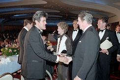 Leno shaking hands with President Ronald Reagan in April 1987