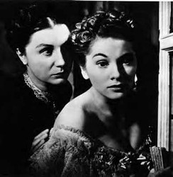 A common theme in thrillers involves innocent victims dealing with deranged adversaries, as seen in Hitchcock's film Rebecca (1940), where Mrs. Danvers tries to persuade Mrs. De Winter to leap to her death.