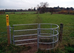 Kissing gate with yellow footpath markings