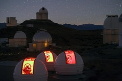 The ExTrA telescopes at La Silla observes at infrared wavelengths and adds spectral information to the usual photometric measurements.[56]
