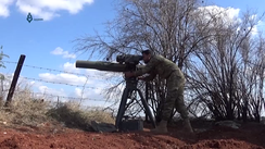 An Army of Glory fighter firing a BGM-71 TOW at a Syrian Army target north of Hama, Syria, in March 2017
