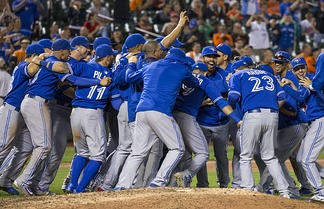 The Blue Jays celebrate after clinching the American League East in 2015; they went as far as the ALCS, only to lose against the eventual World Series-winning Kansas City Royals.