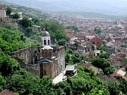 Burned and destroyed Serbian church and houses in Prizren during the 2004 unrest in Kosovo