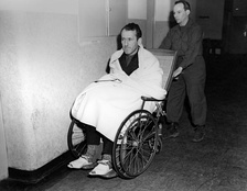 Kaltenbrunner wheeled into court during the Nuremberg trials after a brain haemorrhage during interrogation.