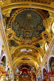 Quadratura; a painted dome by Andrea Pozzo for the Jesuit Church, Vienna, giving the illusion of looking upwards at heavenly figures around a nonexistent dome (1703)