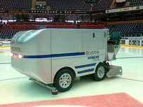An ice resurfacer on an indoor ice rink