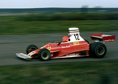 Niki Lauda taking the Ferrari 312T through Maggotts Copse during 1975 John Player Grand Prix, Silverstone