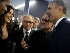 Bono and his wife, Ali Hewson, with President Obama at Nelson Mandela's funeral in South Africa, December 2013