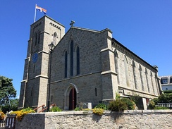 The Scillonian Cross flying above St Mary's Church in Hugh Town.