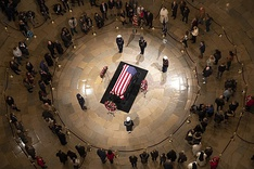Members of the public pay their respects at the casket of George H. W. Bush lying in state in the Rotunda of the U.S. Capitol in Washington, D.C.