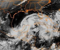 Tropical Storm Opal emerging into the Gulf.
