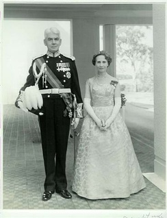 Viscount Dunrossil, 14th Governor-General of Australia (1960–61), in his court uniform, with his vice-regal consort, Viscountess Dunrossil.