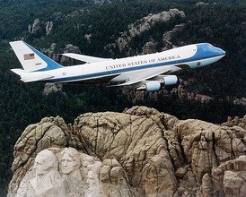 SAM 28000, one of the two VC-25s used as Air Force One, flying over Mount Rushmore in February 2001