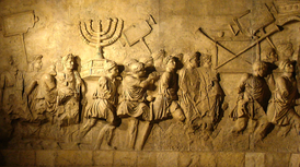 The Menorah of the Temple of Jerusalem, shown carried in the triumphal procession of Titus along with spoils from the Temple on the Arch of Titus in Rome