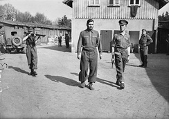 Josef Kramer, photographed in leg irons at Belsen concentration camp before being removed to the POW cage at Celle, 17 April 1945.