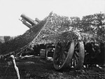Siege howitzer camouflaged against observation from the air, 1917