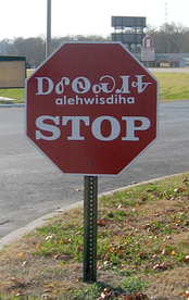 Bilingual stop sign in English and the Cherokee syllabary, Tahlequah, Oklahoma