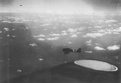 Japanese carrier dive bombers head towards the reported position of U.S. carriers on 7 May.