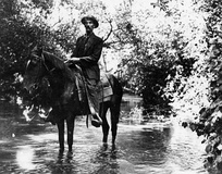 Ed Hunt, Griffith Park policeman, in the Los Angeles River, 1911