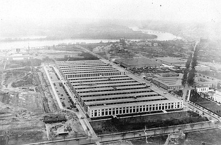 Main Navy Building (foreground) and the Munitions Building were temporary structures built during World War I on the National Mall. The Department of War headquarters was in the Munitions Building for several years before moving into the Pentagon.