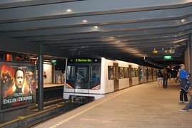 A Metro train leaving Nationaltheatret Station