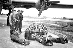 466TH BOMB GROUP, 786th Sq, Dougherty Crew # 612. While waiting for a delayed mission, crew members were taking it easy when a jeep rolled up and a photographer took this picture.