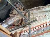 The facade of the Macedonian Tomb of the Palmettes in Mieza, Macedonia, Greece, 3rd century BC; decorated by colored Doric and Ionic moldings, the pediment is also painted with a scene of a man and woman reclining together.[318]