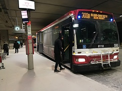 A passenger boards a TTC bus at Terminal 1 (2018)