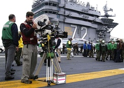 A camera crew sets up for scenes from the movie Stealth to be filmed on the flight deck with the crew
