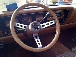 Adjustable three-spoke steering wheel on a collapsible column in an AMC Matador from the 1970s