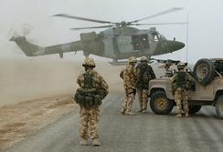 A Lynx Helicopter of the British Army Air Corps ready to touch down on a desert road south of Basra Airport, November 2003