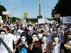 Protesters against NSA data mining in Berlin wearing Chelsea Manning and Edward Snowden masks