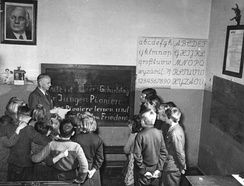 "GDR ""village teacher"", a teacher teaching students of all age groups in one class in 1951"