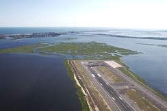 The south end of Runway 4L at JFK Airport extending into Jamaica Bay, with the Rockaways in the distance.