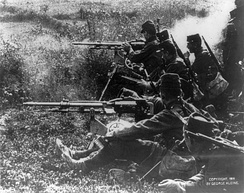 A detachment of French infantry with 2 Saint-Etienne Model 1907 machine guns (c. b1914)