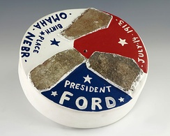 Plaster of Paris disc composed of three pieces of bricks from Gerald R. Ford's birthplace in Omaha, Nebraska.