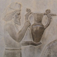 Detail of a relief of the eastern stairs of the Apadana, Persepolis, depicting Armenians bringing an amphora, probably of wine, to the king.