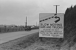 This sign, photographed in 1941 on US 99 between Seattle, Washington, and Portland, Oregon, illustrates one rationale for a federal highway system: national defense.