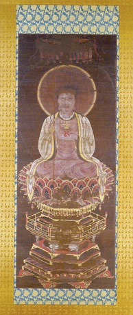 Manichaean Painting of the Buddha Jesus depicts Jesus Christ as a Manichaean prophet. The figure can be identified as a representation of Jesus Christ by the small gold cross that sits on the red lotus pedestal in His left hand.